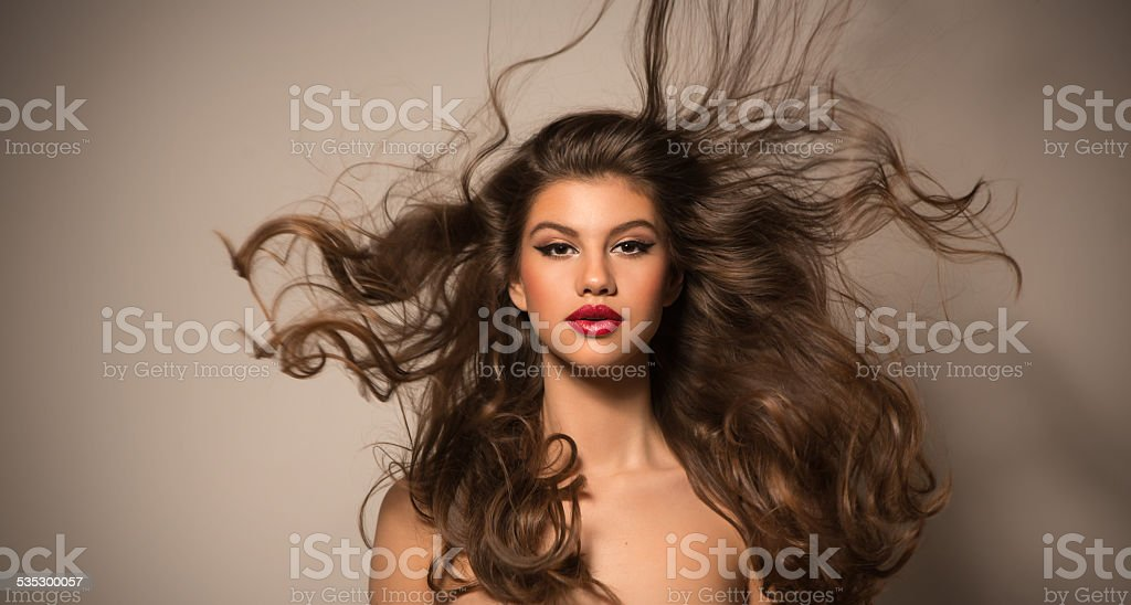 Brunette woman with flying hair. stock photo