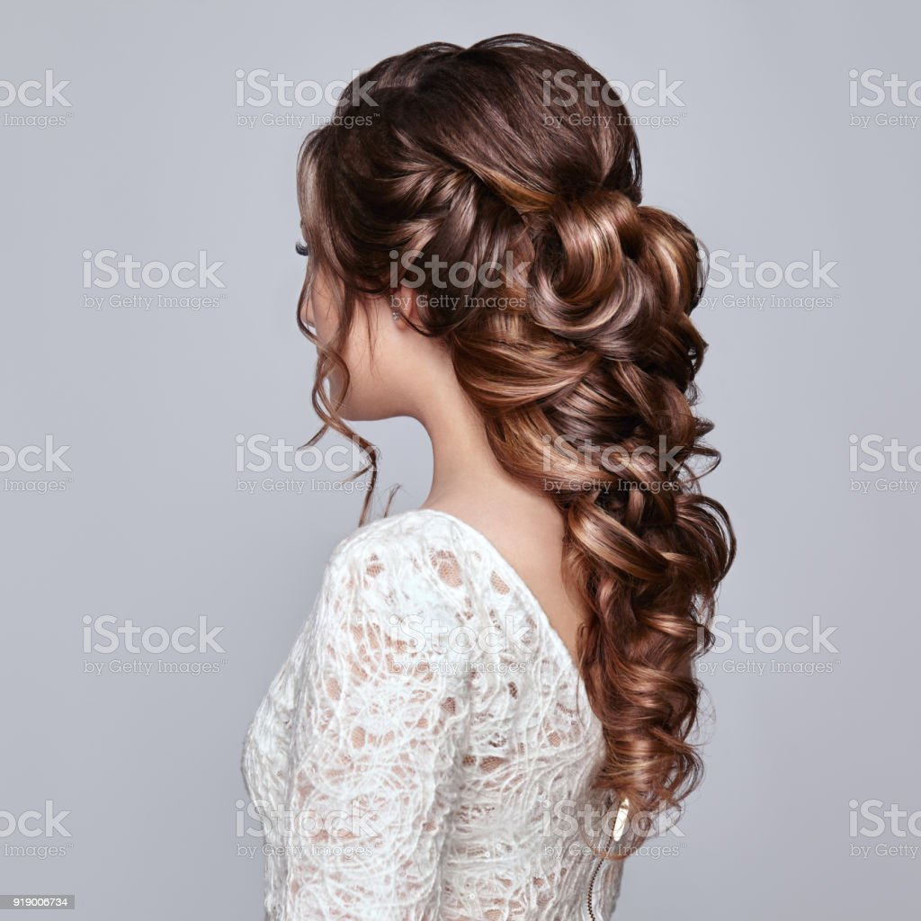 Brunette woman with long and shiny curly hair stock photo