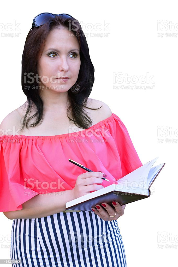Brunette wrote in the diary isolated on a white background stock photo