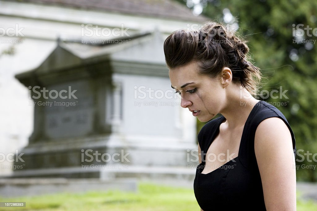 Brunette Young Woman Mourning at Graveyard, Copy Space stock photo