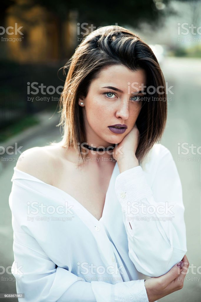 Brunette young woman outdoor portrait stock photo