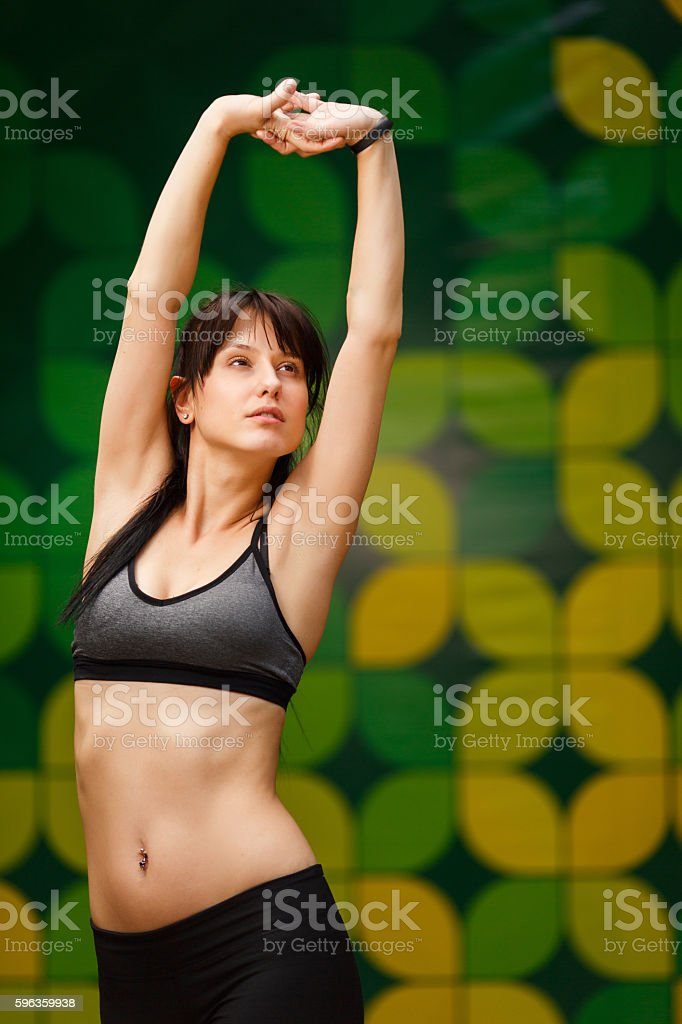Brunette young woman preparing for training in gym royalty-free stock photo