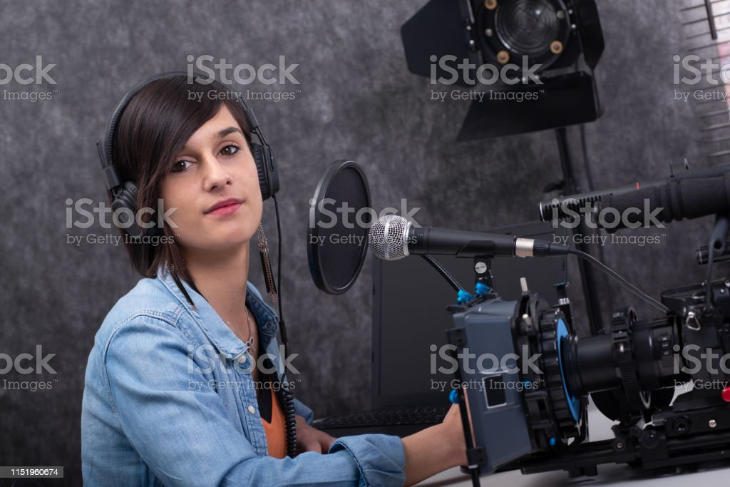 brunette young woman working on the radio studio