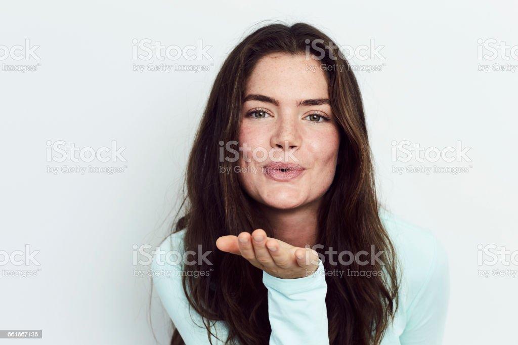 Brunette's kiss stock photo