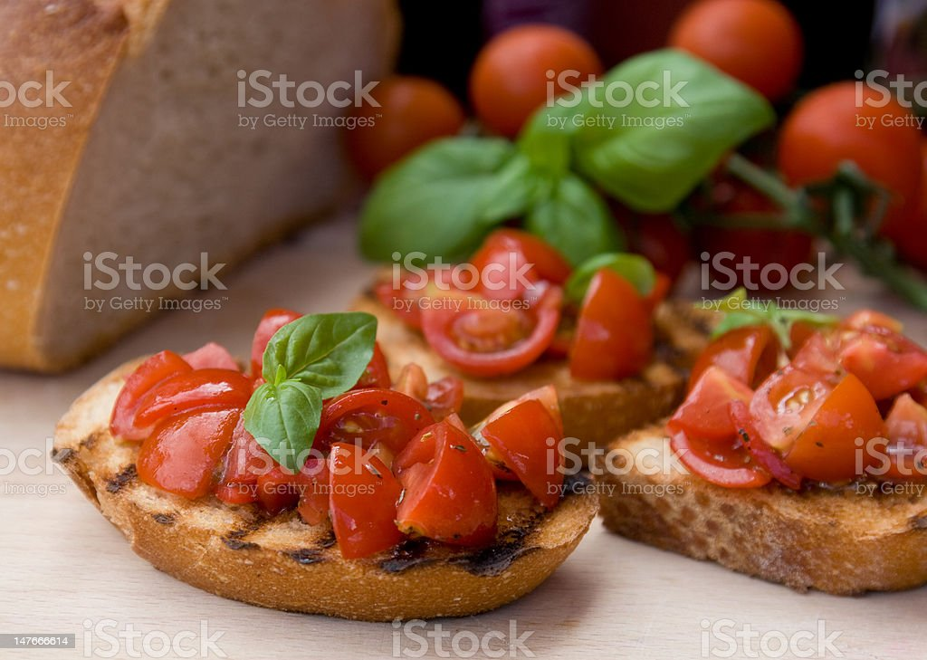 Bruscetta (italian toadted bread with tomatoes) royalty-free stock photo