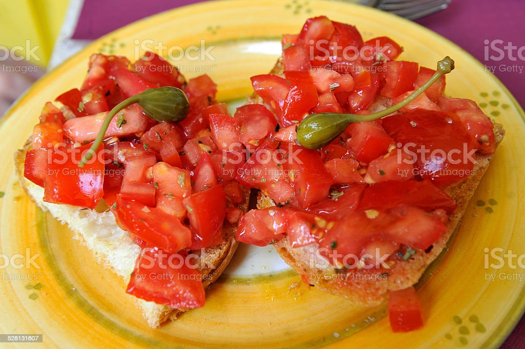 Bruscetta with tomatoes and capers stock photo