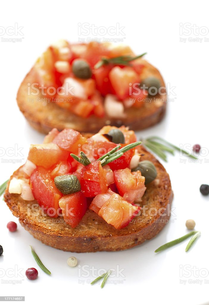 Bruscetta with tomatoes and rosemary stock photo