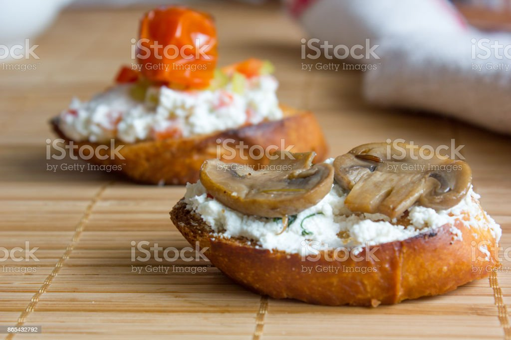 Bruschetta. Delicious and fresh bruschetta with the goat cheese and mushrooms. stock photo