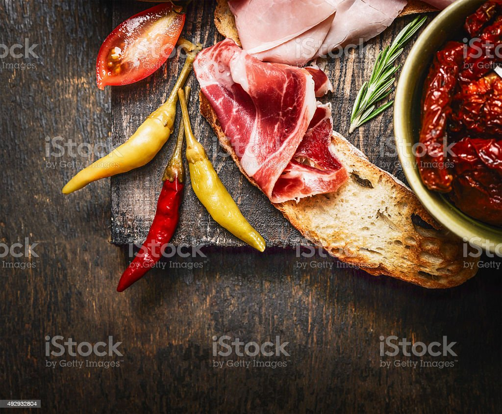 bruschetta or crostini with italian ham and antipasto , close up stock photo