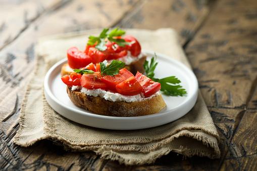 Homemade bruschetta with cream cheese and tomato
