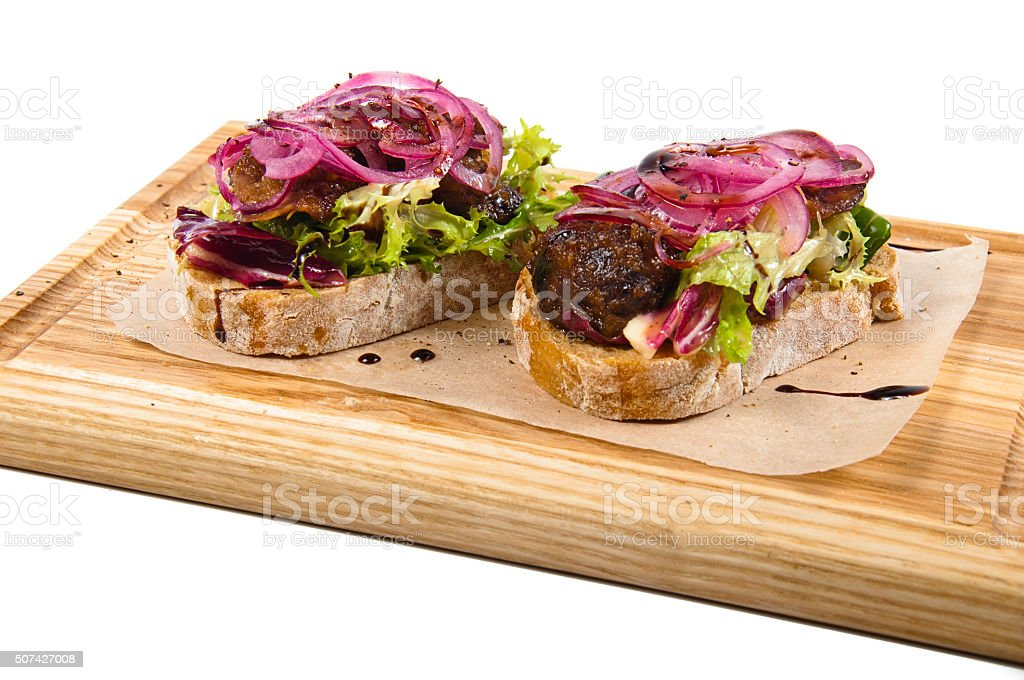 Bruschetta with caramelized chicken liver stock photo