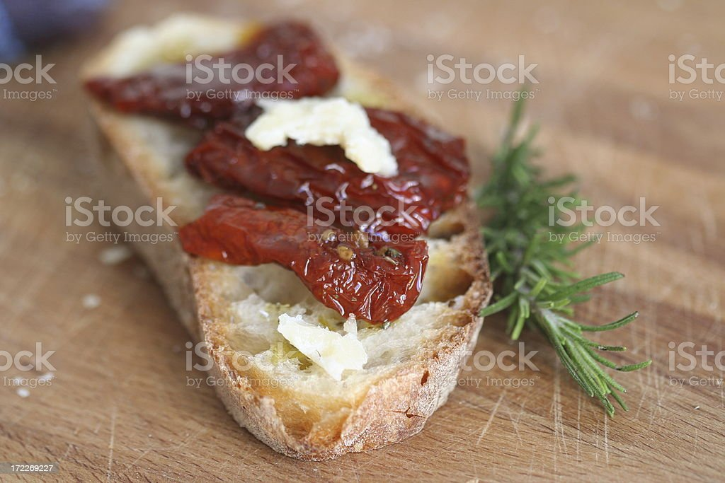 Bruschetta with Dried Tomato and Rosemary spice royalty-free stock photo
