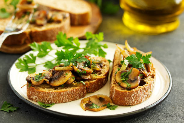 Bruschetta with fried mushrooms with onions and parsley. stock photo