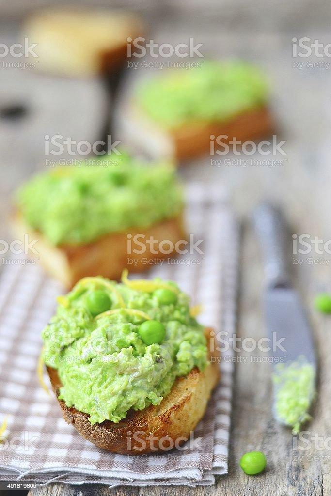 bruschetta with green pea stock photo