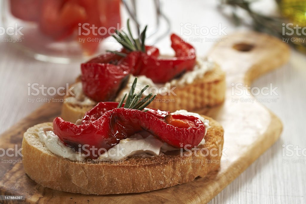 Bruschetta with grilled pepper, cheese and rosemary royalty-free stock photo