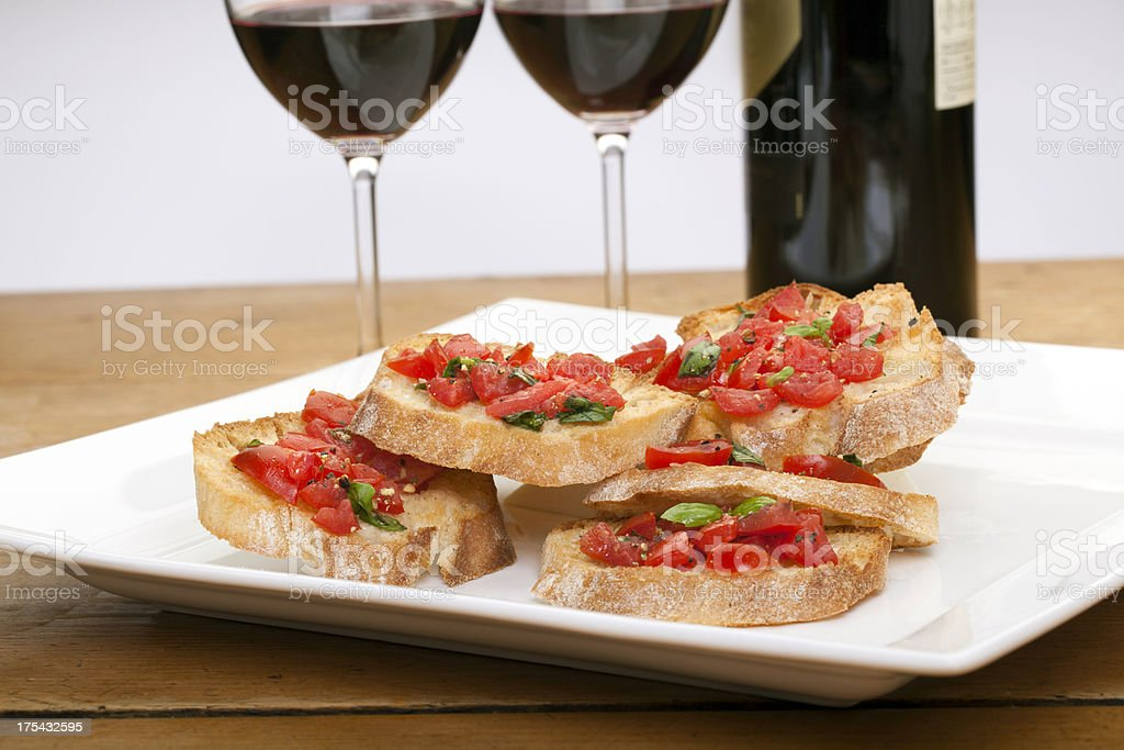 Bruschetta with red wine royalty-free stock photo