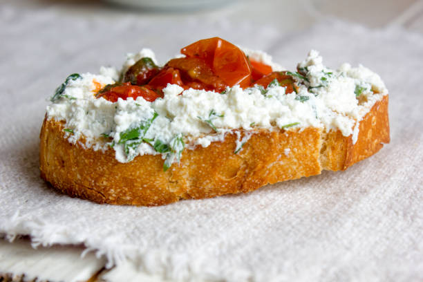 Bruschetta with ricotta cheese and tomato sauce form of heart stock photo