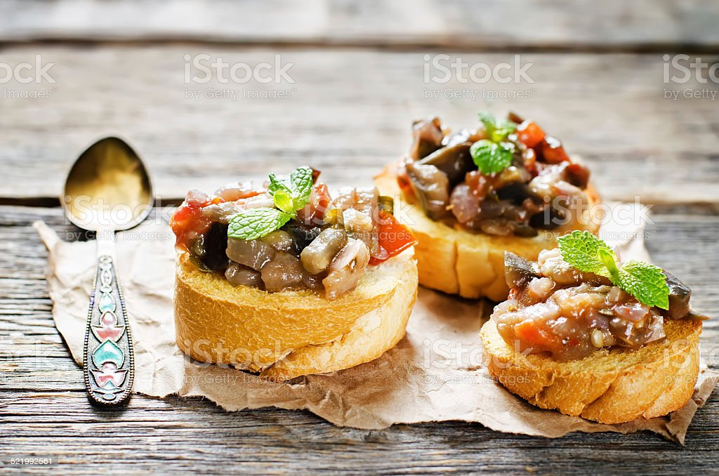 bruschetta with roasted eggplant and tomatoes stock photo