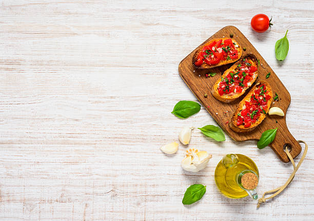 Bruschetta with Tomato and Basil in Top View Copy Space - foto stock