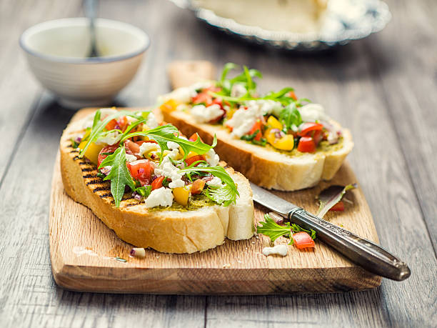 Bruschetta with tomato and rocket - foto de stock