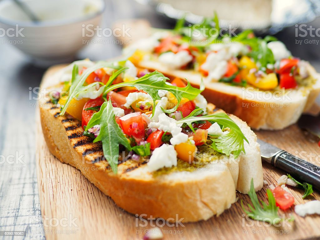 Bruschetta with tomato and rocket stock photo