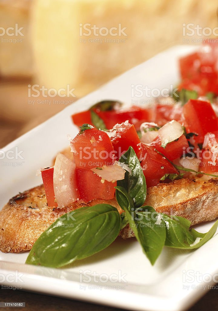 Bruschetta with tomato, mozzarella and basil stock photo