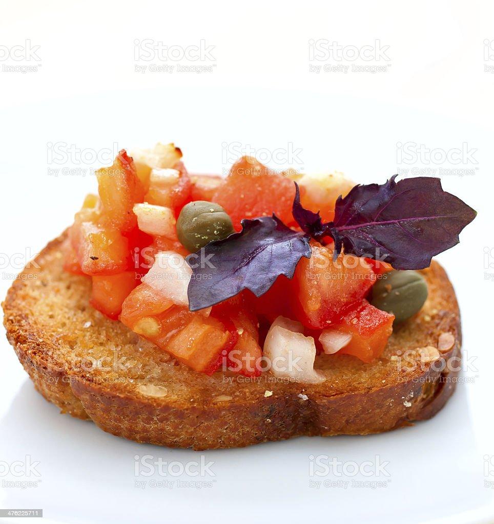 Bruschetta with tomatoes and basil stock photo