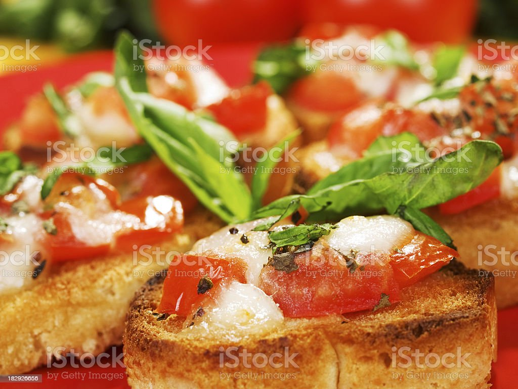 Bruschetta with tomatoes, cheese, and basil royalty-free stock photo