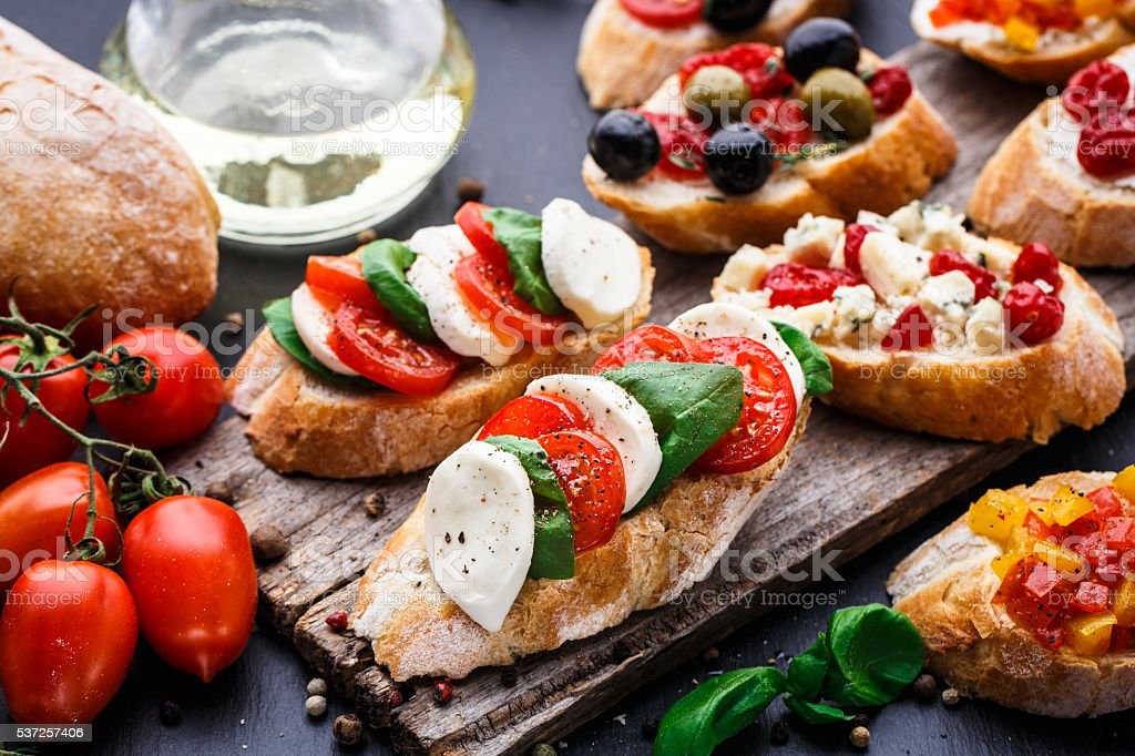 Bruschetta with tomatoes, mozzarella and basil stock photo