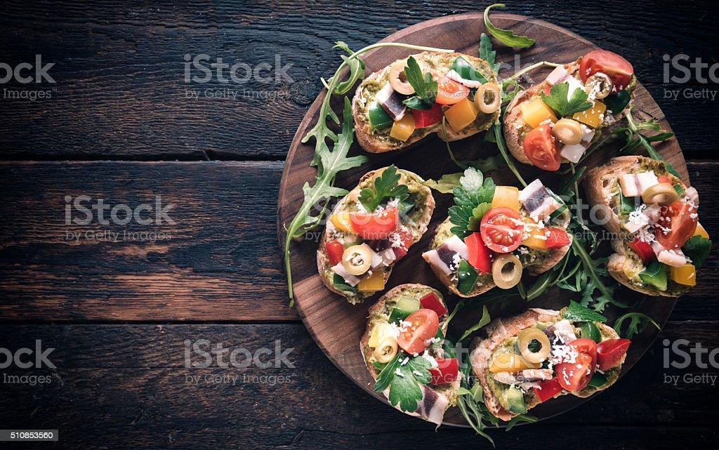 Bruschettas served on the table stock photo