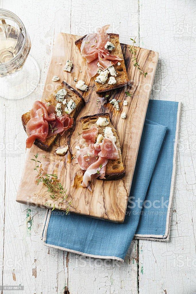 Bruschettas with Blue cheese and ham stock photo