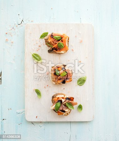 istock Bruschettas with Prosciutto, roasted melon, soft cheese and basil on 514366308