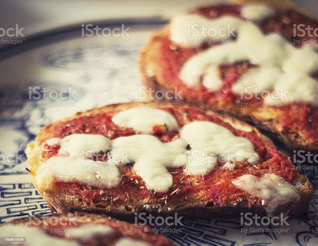 Bruschette of Pizza on the table stock photo
