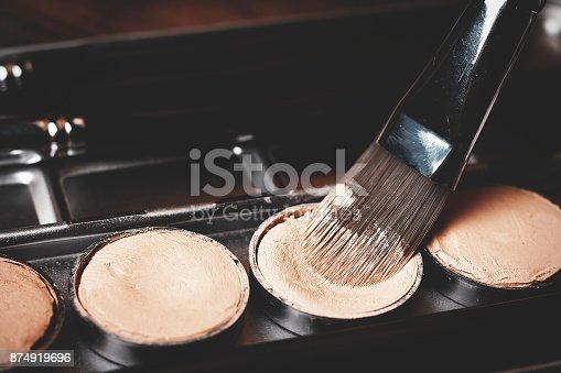 istock Brush and cream concealer. Professional cosmetic. Cream concealer. 874919696