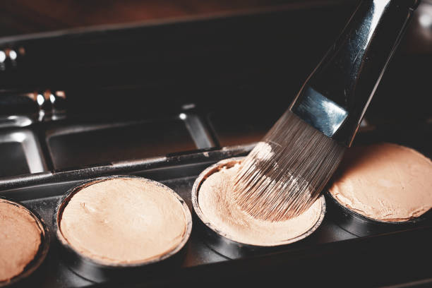 brush and cream concealer. professional cosmetic. cream concealer. - defects stock pictures, royalty-free photos & images
