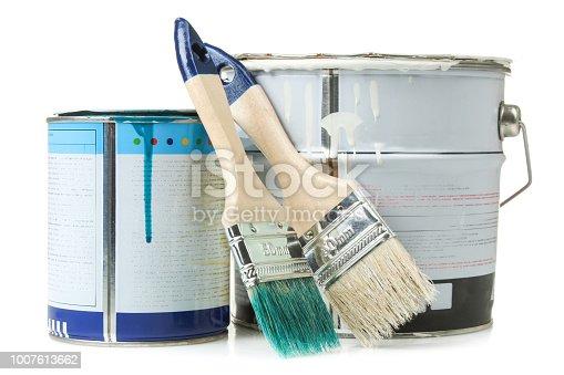 Brush and paint jar isolated on white background