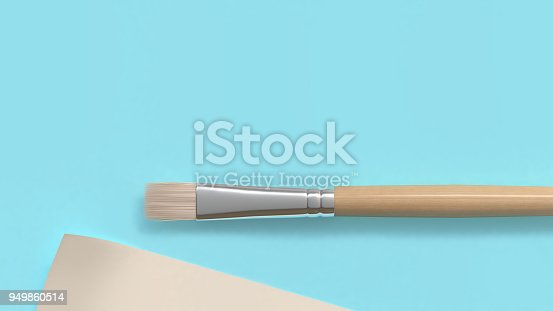 949860388istockphoto brush and paper on blue background 3d rendering 949860514