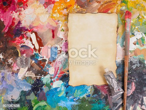 629775804 istock photo Brush and paper on oil-paint palette for background 507082638