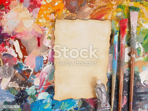 629775804 istock photo Brush and paper on oil-paint palette for background 507082908