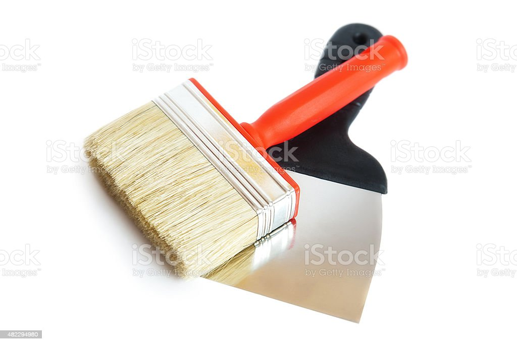 Brush and spatula, white background stock photo