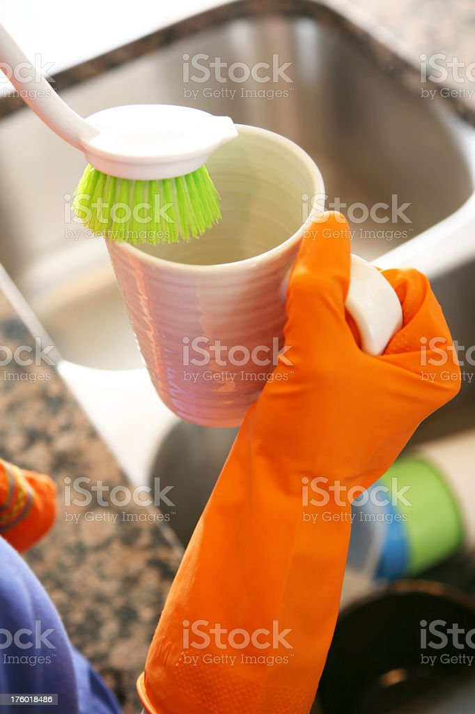 Brush Being Used to Clean a Coffee Cup royalty-free stock photo