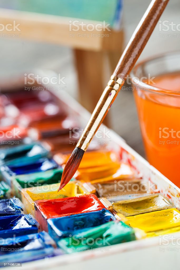 Brush for painting closeup and set of watercolor paints. stock photo