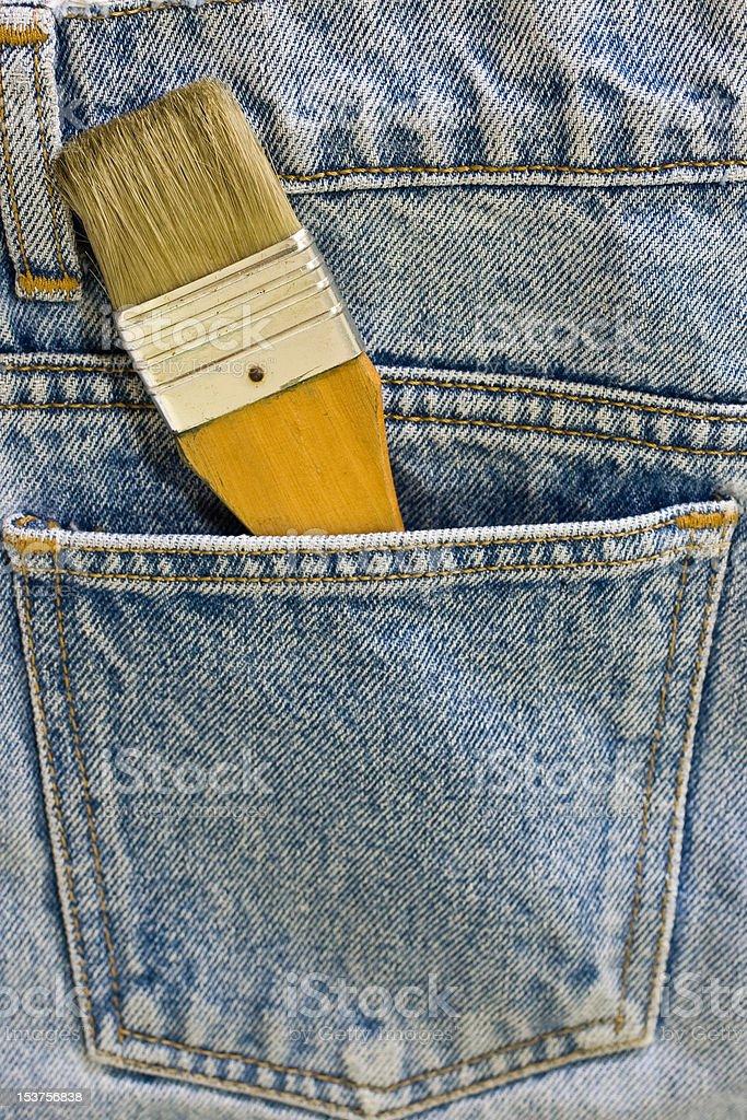 Brush inside the pocket jeans royalty-free stock photo