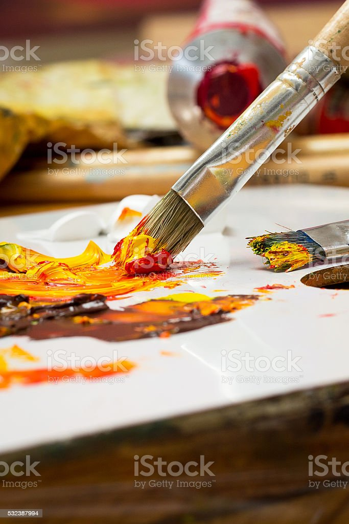 Brush mixing oil painting. stock photo