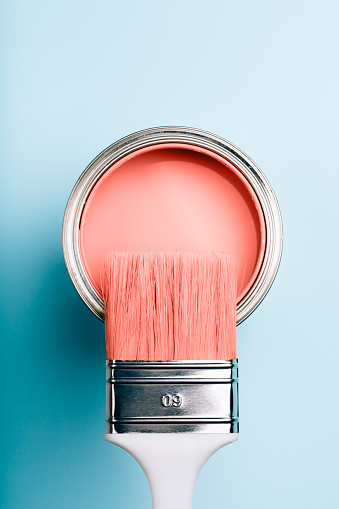 Brush On Open Can Of Living Coral Paint On Blue Pastel Background Stock Photo - Download Image Now
