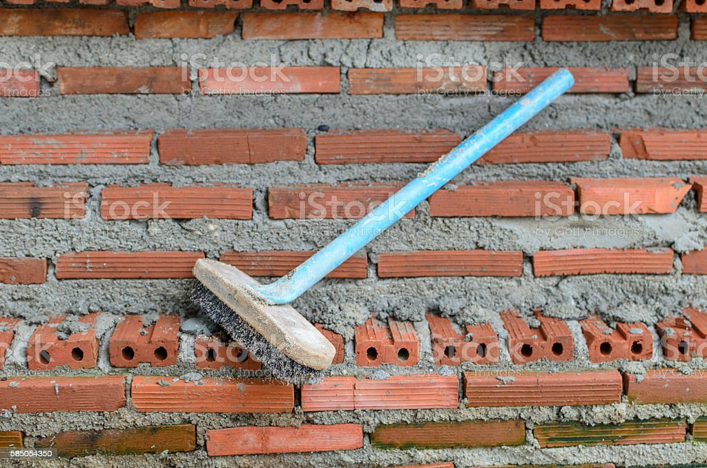 Brush on red brick wall stock photo
