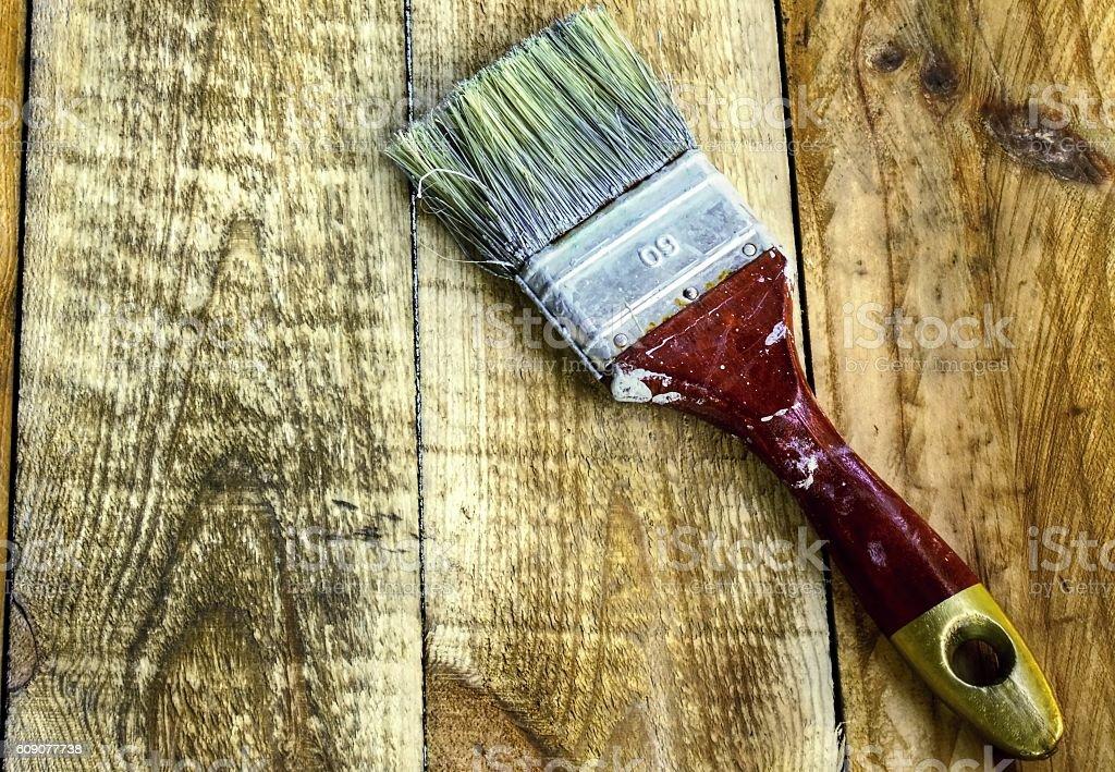 Brush on the wood planks stock photo