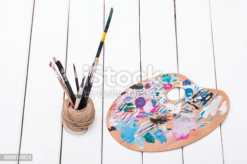 510006691 istock photo Brush paint and wooden art palette 636614824