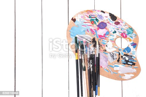 510006691 istock photo Brush paint and wooden art palette 636616964