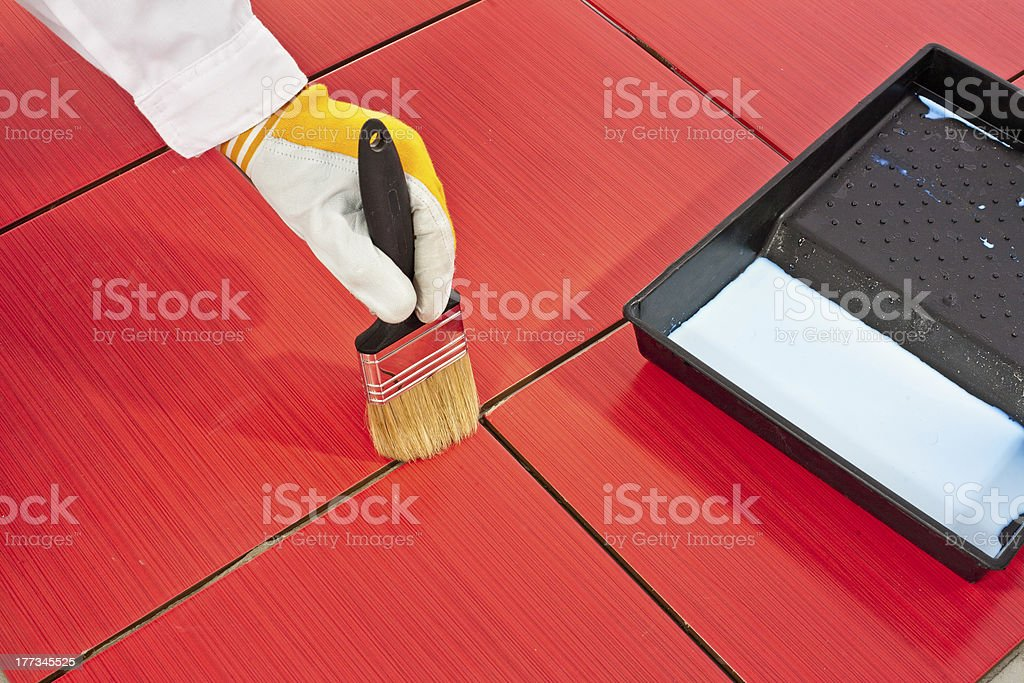 brush primer grout of red tiles resistant royalty-free stock photo